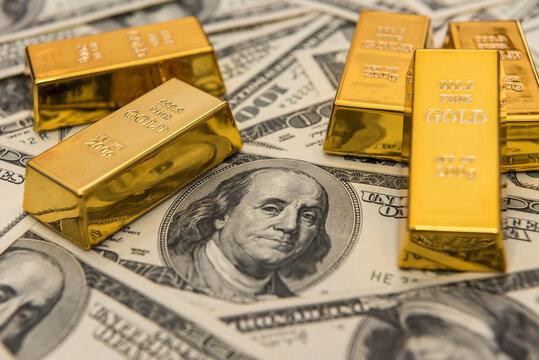 gold bullion bars on usd money bills. Success concept