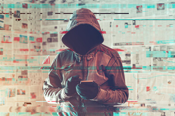Hooded hacker person using smartphone in infodemic concept