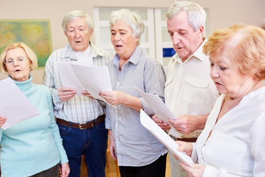 Senior group sings together in a choir