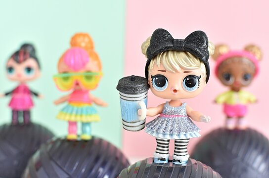 L.O.L. surprise dolls from Glitter series, pink and mint background,   January 21, 2019 in Vilnius Lithuania.