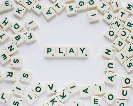 Word PLAY made from Scrabble game letters on white background, May 14, 2018 in Vilnius Lithuania.