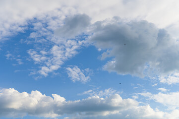 Blue sky with amazing vibrant clouds and birds