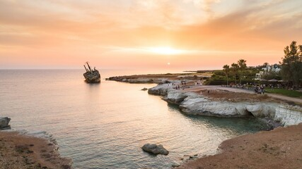 Photo Blinds Shipwreck Aerial bird's eye view of the abandoned ship wreck EDRO III in Pegeia, Paphos, Cyprus from above at sunset. Rusty shipwreck stranded on Peyia rocks at sea caves, Coral Bay in Pafos, standing on coast.
