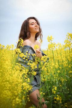 Beautiful woman relaxing in raps field