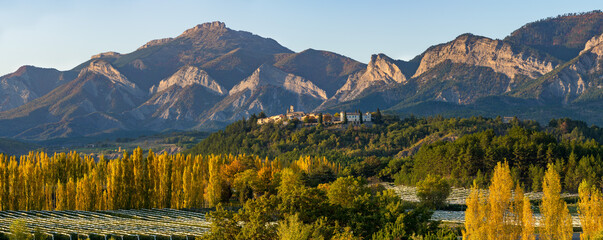 Acrylic Prints Alps The hilltop village of Ventavon in Autumn with peuplar trees and orchards (panoramic). Durance Valley, Hautes-Alpes, European Alps, France