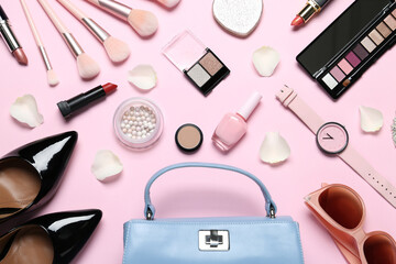 Stylish shoes, makeup products and accessories on pink background, flat lay