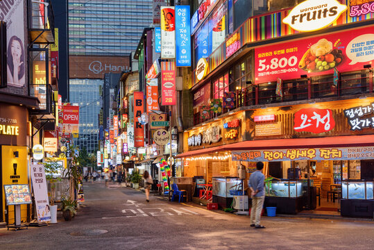 Evening view of illuminated colorful signboards on street, Seoul