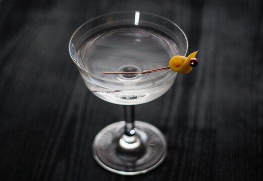 Vesper martini cocktail with a lemon peel garnish.