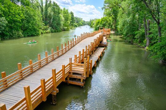 Korzo Zalesie - area for leisure activities with wooden bridge walk by Little Danube river in village of Zalesie (SLOVAKIA)
