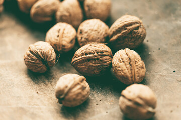 Walnuts on a wooden table. Macro image. Papier Peint