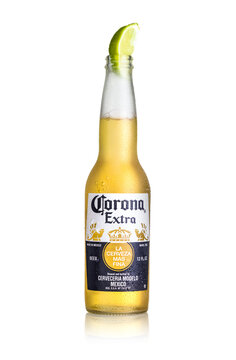 Corona Extra Beer with lime isolated on white background
