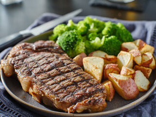 Garden Poster Steakhouse grilled new york steak with broccoli and roasted potatoes