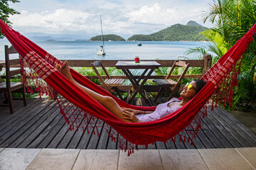 woman relaxing in hammock on the tropical island og Ilha Grande