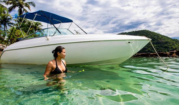 woman swimming at the green lagoon on the tropical island Ilha Grande