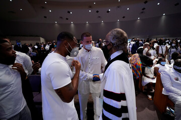 Actor Channing Tatum shakes hands with the Rev. Al Sharpton after the funeral service for George Floyd at the Fountain of Praise church, in Houston