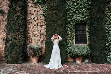 Young bride standing near old estate