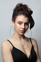 Portrait of young beautiful girl with fancy circle earrings and temporary tattoo