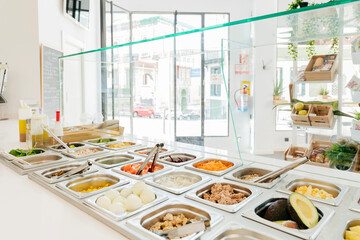 Modern restaurant with self service system and served delicious foods and dishes in metal warm container on counter