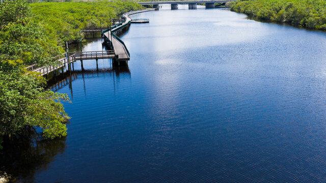 Low aerial view of the boardwalk on the St Lucie River in Port St Lucie Florida