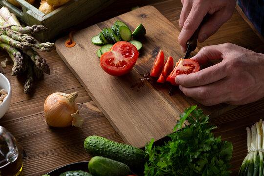 Sliced tomatoes on wooden board, cooking vegan food