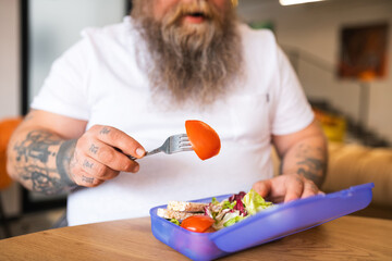 Close up picture of a man having his lunch