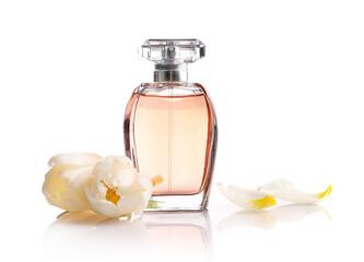 Beautiful perfume bottle and tender white tulips