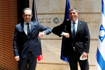 Israeli Foreign Minister Gabi Ashkenazi and his German counterpart Heiko Maas greet each other during their meeting in Jerusalem