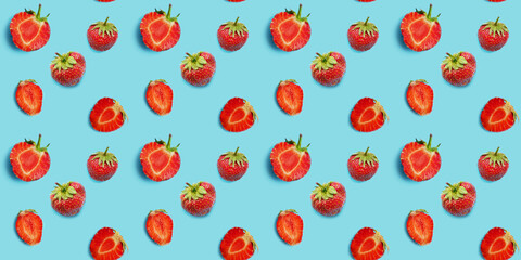 Fototapete - Seamless food pattern, ripe strawberries on a blue background. Creative flat layout, top view.