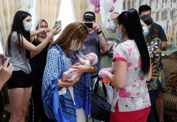 Andrea Diez and Fernando Montero, Argentine citizens and parents of newborn Ignacio, attend their first meeting in Kiev
