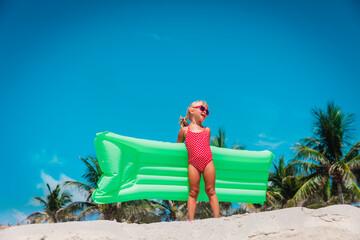cute little girl go swim on tropical beach