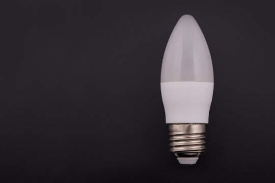 Electric bulb of LED. White on a black background.