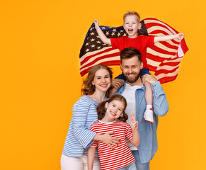 Happy family with the USA flag.