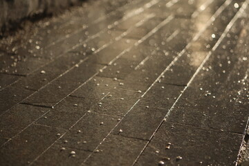 contrasty filled frame background wallpaper photo of dark wet shiny tile with drops of rain and...