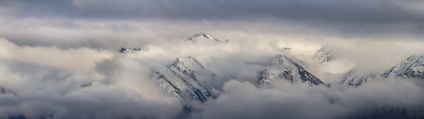 Mountain peaks in the clouds Ile Alatau National Park Tien Shan