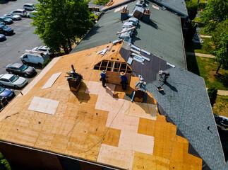 Fototapeta Construction worker on renovation roof the house installed new shingles obraz