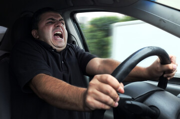 Angry man driver dangerously driving car without seat belts