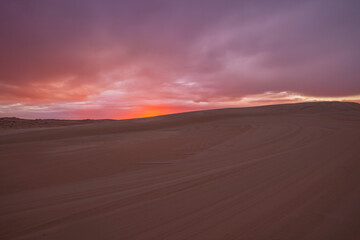 Canvas Prints Magenta Colourful clouds over sand dunes at Myall Lakes National Park.East Coast of N.S.W. Australia.