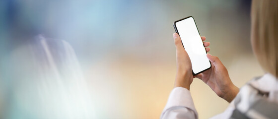 Businesswoman using blank screen smartphone with bokeh Background
