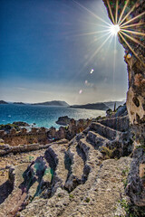 A broken castle sits on the hillside, overlooking the Bosphorus Strait in the village of Kale in Turkey