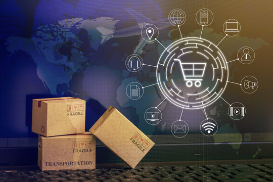 Shopping online, e-commerce concept: Cardboard boxes with icon customer network connection on keyboard. depicts of transportation that can be done easily using an online internet.