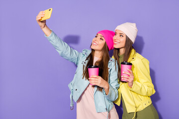 Fototapete - Portrait of nice attractive lovely pretty cheerful cheery girls drinking latte taking making selfie travel traveler isolated on bright vivid shine vibrant violet lilac purple color background