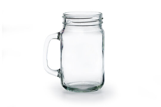 Empty glass jar on white ground.