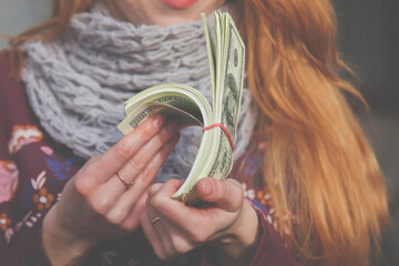 Young business woman with US Dollar bills. Earnings, profits, accounting concept.