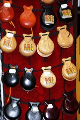 Wooden castanets for sale outside a shop in the town centre, Cordoba, Spain.