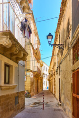 Wall Mural - Old street in the Old City of Syracuse in Sicily