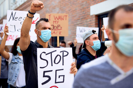 Crowd of people protesting against setting up 5G network around the world.