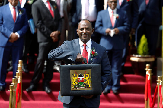 Kenya's Finance Minister Ukur Yatani holds up a briefcase containing the Government Budget for the 2020/21 fiscal year in Nairobi