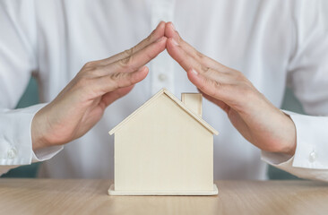 Home insurance protection and property ownership for rent, sale, leasing and safety concept with new house in landloard or real estate realtor, renter or tenant hand.