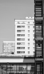 Black and white picture of 2 stacked buildings.