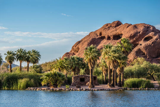 A view of the unique sandstone formation known as Hole-in-the-Rock from across a pond in Arizona's Papago Park.